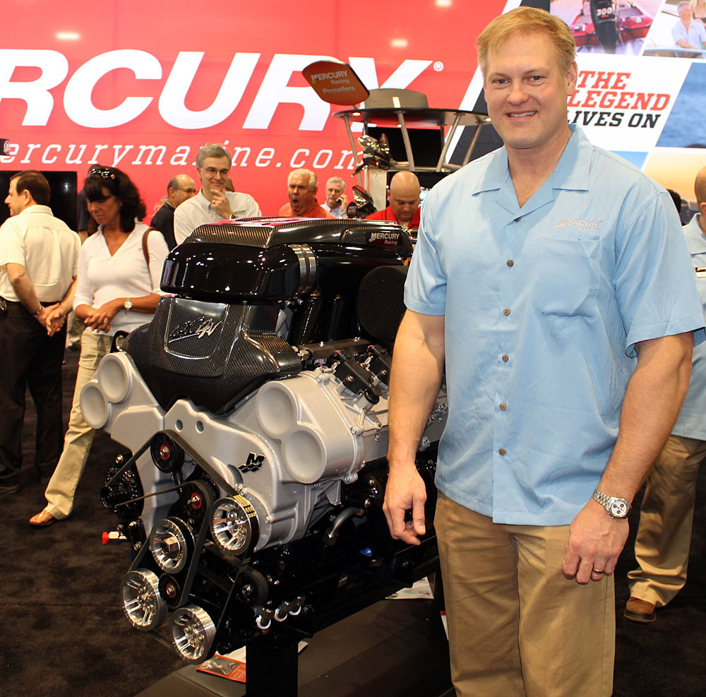 Mercury Racing's Erik Christiansen stands next to the 1650 Race engine at its Miami Boat Show debut.