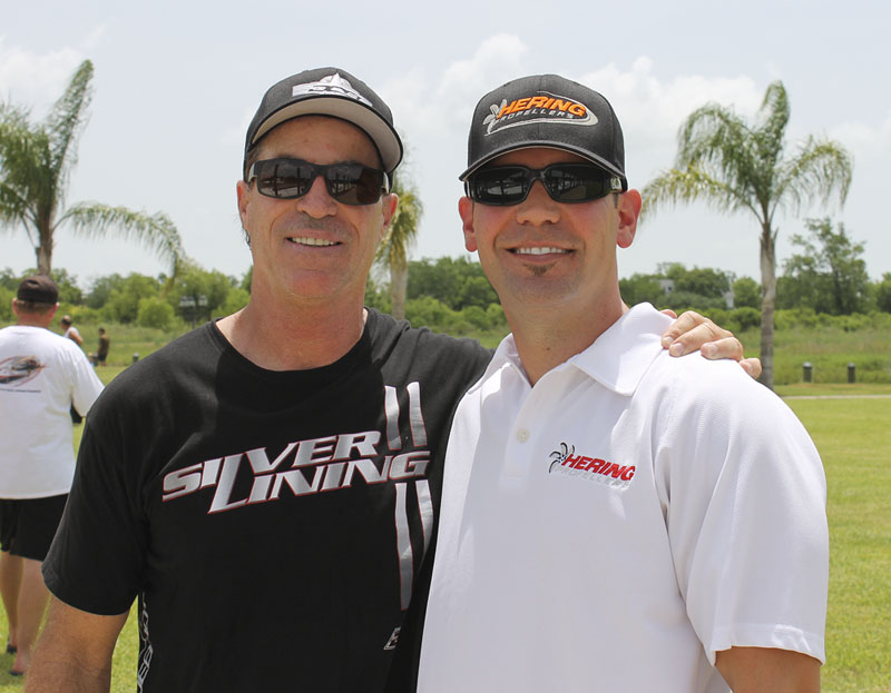 Jeff Johnston (right) joins Dave Hemmingson of Dave's Custom Boats at the Texas Outlaw Challenge in June.