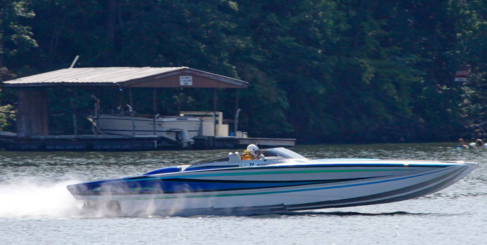 With Arneson Surface Drives putting the power to the water, Louis Marchese's Skater catamaran ran 154 mph at the 2013 Lake of the Ozarks Shootout. Photo courtesy/copyright JHelmkamp-Photos.com/Boatfreaks.org.