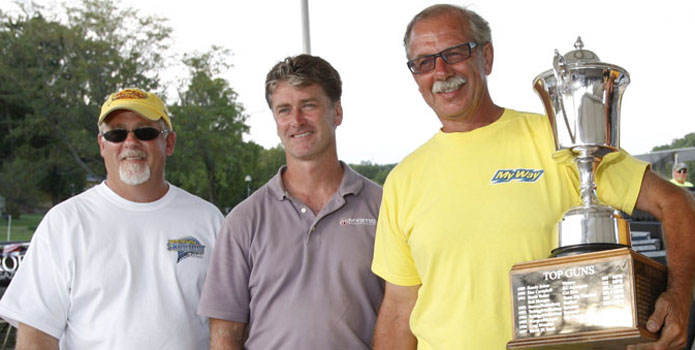 Duggan presents the 2011 Top Gun trophy to Bill Tomlinson (holding trophy), joined by throttleman Ken Kehoe (right) and Mystic Powerboats owner John Cosker. (Photos courtesy of Ron Duggan & Robert Brown.)