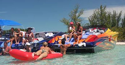 Rafting up at the pristine beaches is a tradition during the Bahamas Poker Run. Photo courtesy Florida Powerboat Club