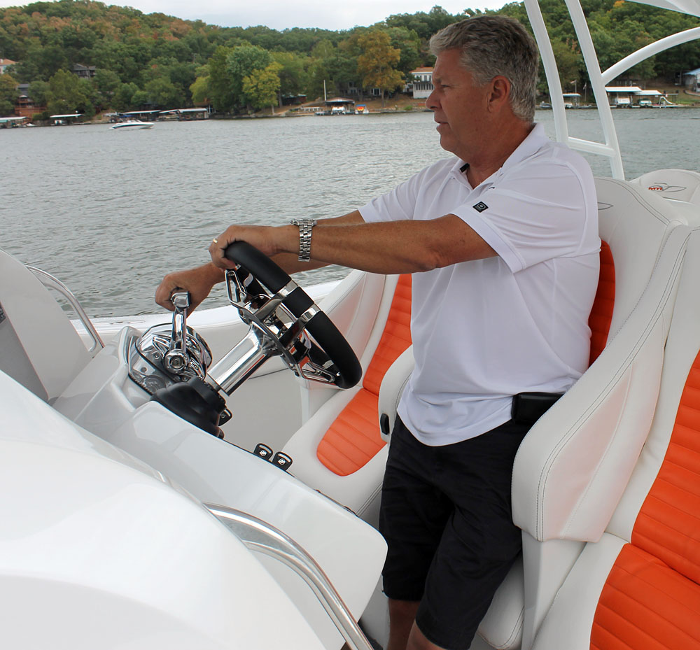 MTI owner and founder Randy Scism proudly mans the helm of his company's first V-bottom model. Photo by Jason Johnson