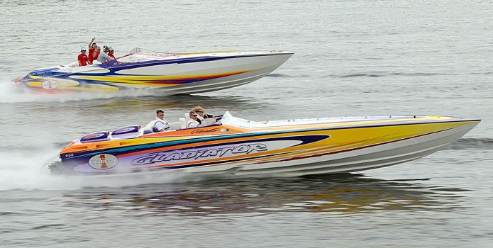 A pair of Cigarette Racing V-bottoms cruise along Lake of the Ozarks during the Support Our Troops Poker Run.