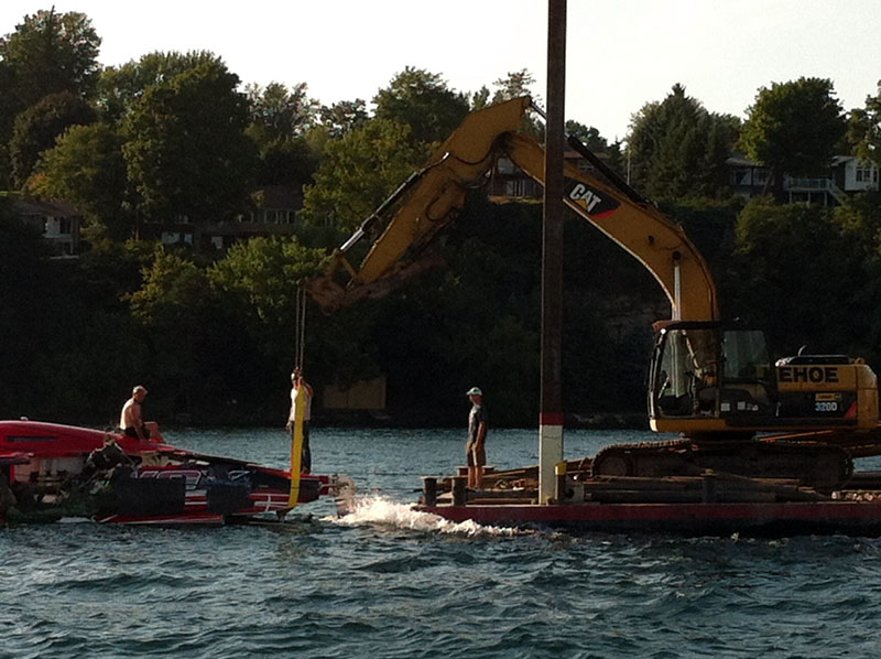 This photo shows the 50-footer being removed from the river after the incident.