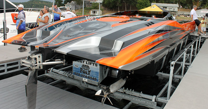 Bob Bull's 48-foot MTI, which ran 186 mph in the Lake of the Ozarks Shootout, sits atop a Poly-Lift boat lift at the docks in front of Captain Ron's.