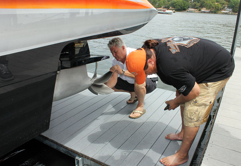 Marine Technology Inc owner Randy Scism inspects a propeller before making a final run in Bob Bull's 48-foot MTI.