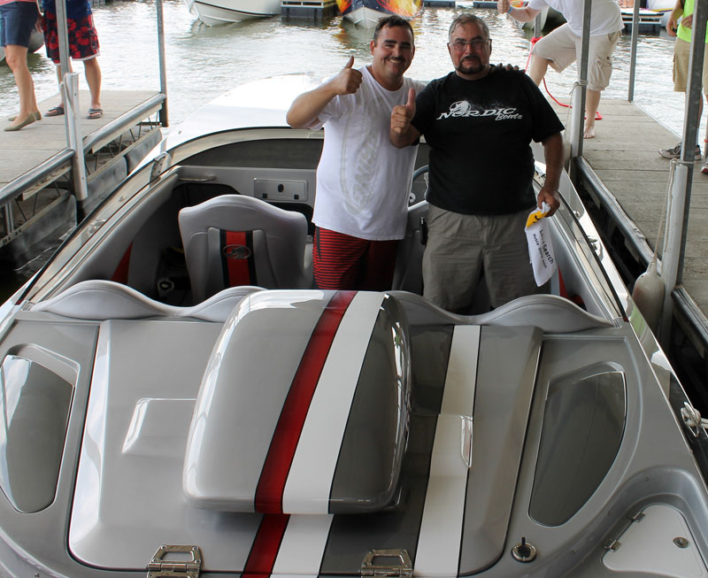 Ivan 'Buck' Stracener and Louis Marchese, give a thumbs up after running the fastest speed for a single-engine boat in Stracener's 28-foot Nordic catamaran.
