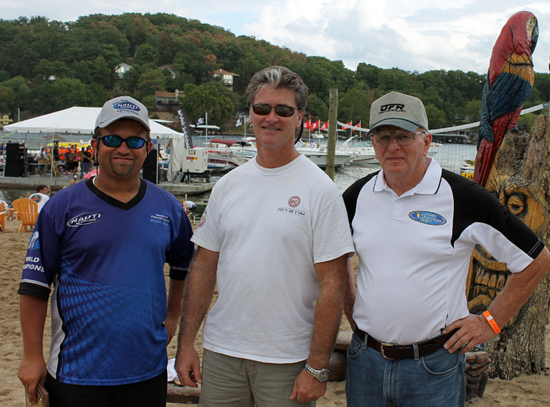 Myrick Coil, John Cosker and Don Onken gather for a photo after winning their class in Onken's 50-foot Mystic catamaran with a 163-mph top speed.