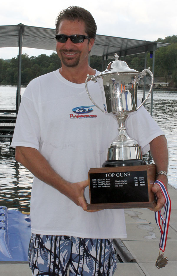 Nebraska's Greg Olson smiles proudly while holding his 2012 Lake of the Ozarks Shotoout Top Gun trophy after running 192 mph in his Eliminator Boats 33 Daytona.